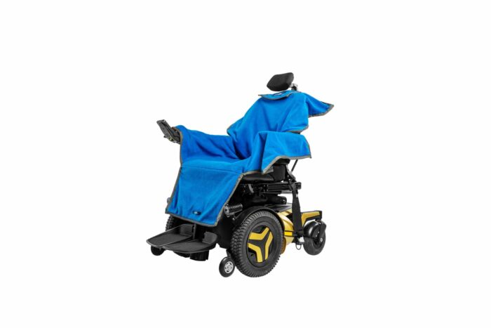 Picture of an electric wheelchair with a blue waterproof towel over the seating area of the wheelchair